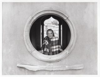 ORIGINAL BLACK AND WHITE PHOTOGRAPH of Charles Bukowski Looking Through a Circular Stone Window in Germany, May, 1978. Charles Bukowski, Michael Montfort.